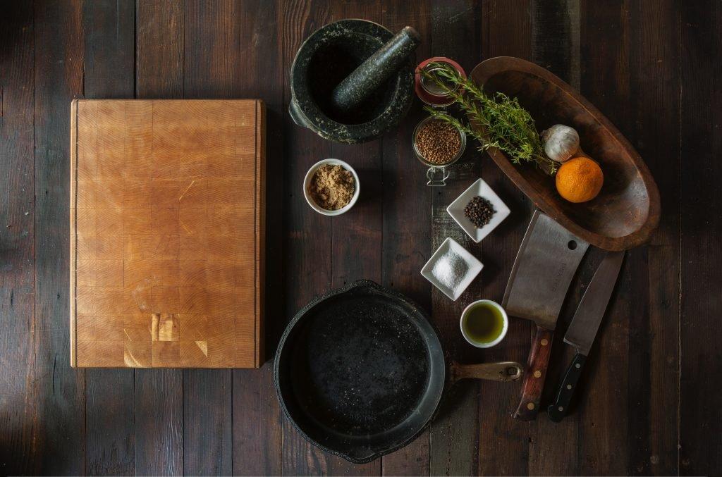 Arrangement of cast iron pan and supplies.